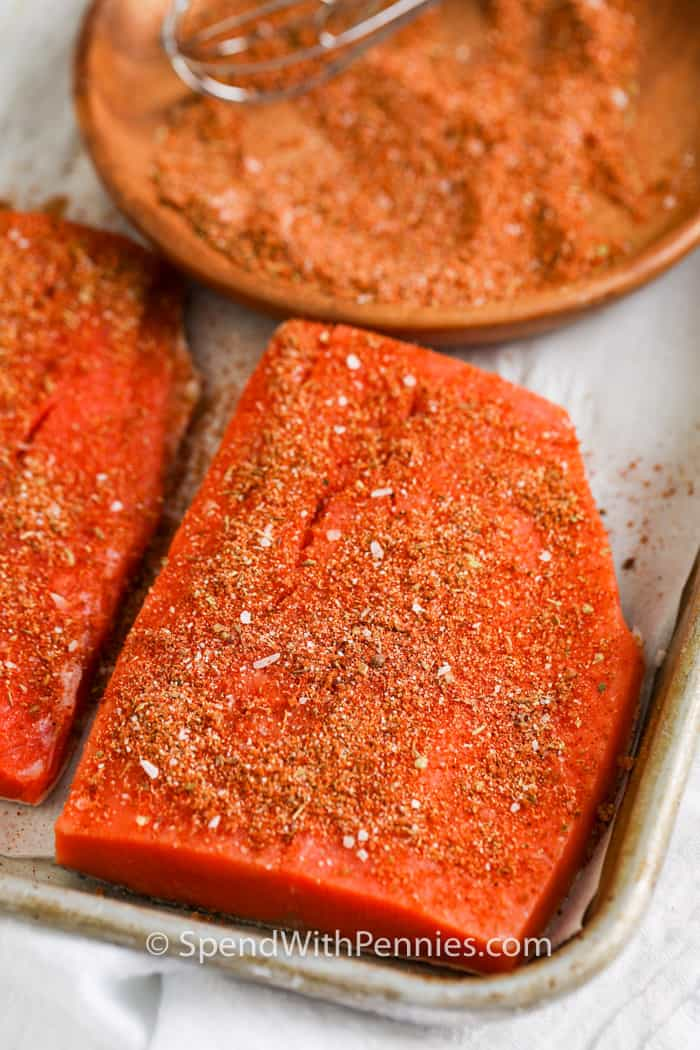 Close up of a salmon fillet seasoned with blackening seasoning