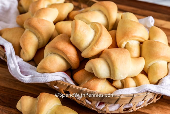 Buttery Crescent Rolls in a basket with a towel