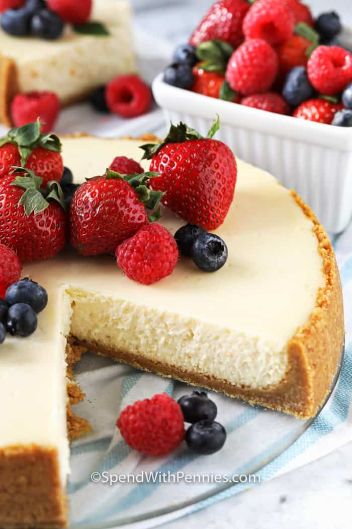 Cheesecake with berries on top and in the background