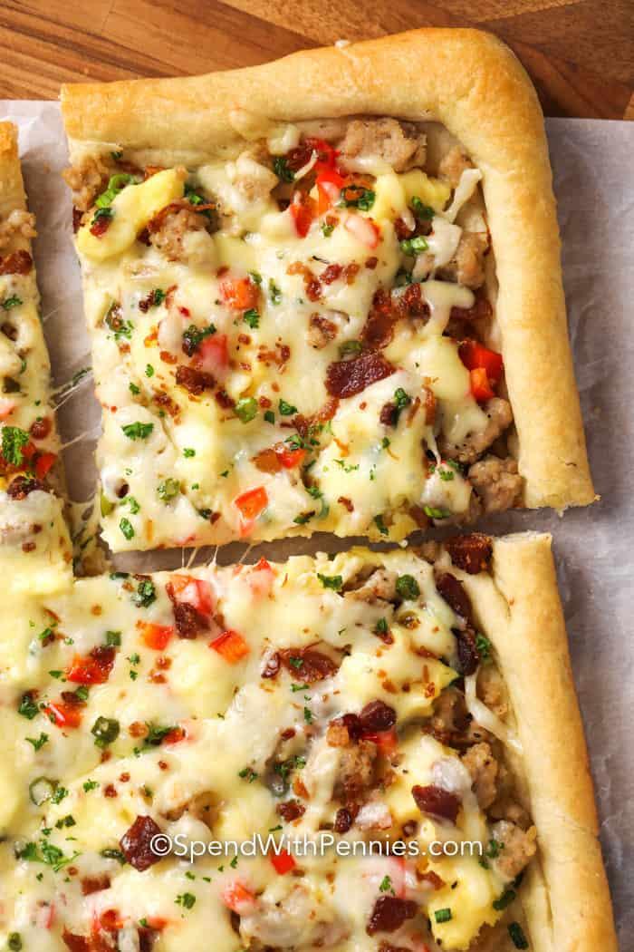 Close up of cheesy breakfast pizza.