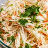 Cilantro Jicama Slaw with cilantro in a glass bowl