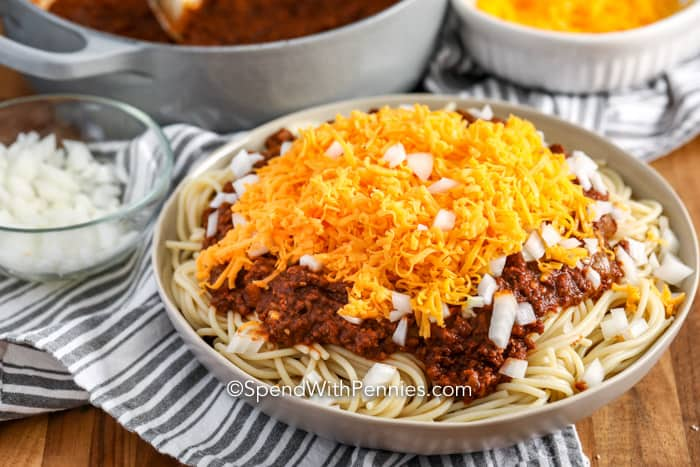 Spaghetti topped with Cincinnati Chili, chopped onions, and shredded cheese.