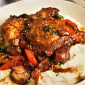 Coq Au Vin with mashed potatoes in a bowl