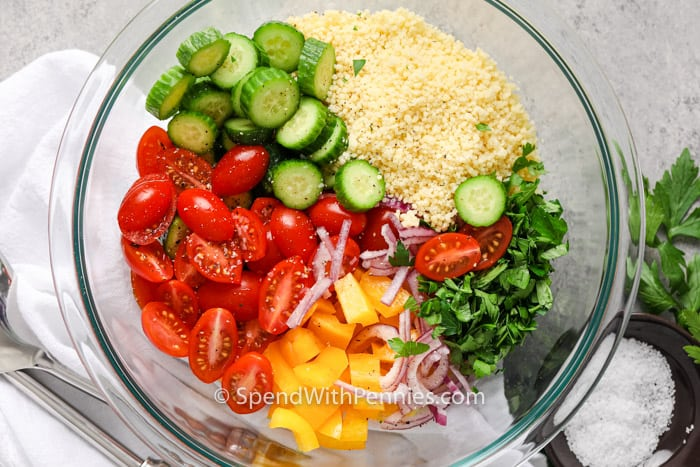 Ingredients for CousCous Salad in a glass bowl