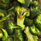 Close up of garlic roasted broccoli in a serving dish.
