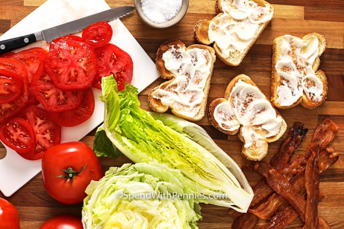 Toasted bread with mayo and other ingredients for BLT sandwich