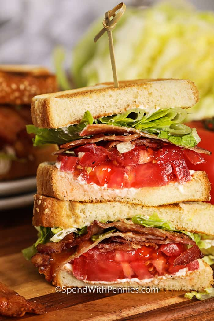 BLT sandwich cut in half with a stick