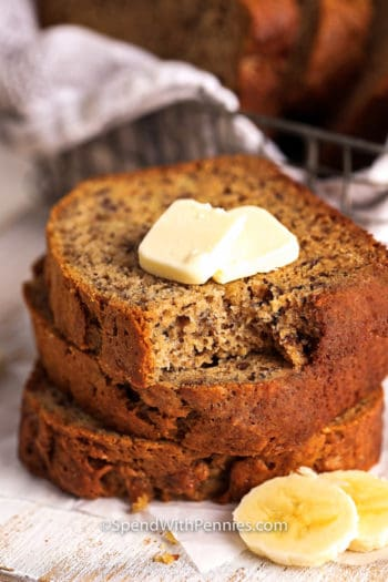 Classic banana bread slices with butter and a bite taken out