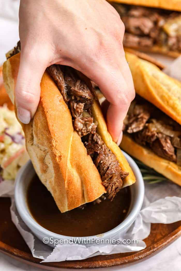 French dip sandwich dipped in au jus