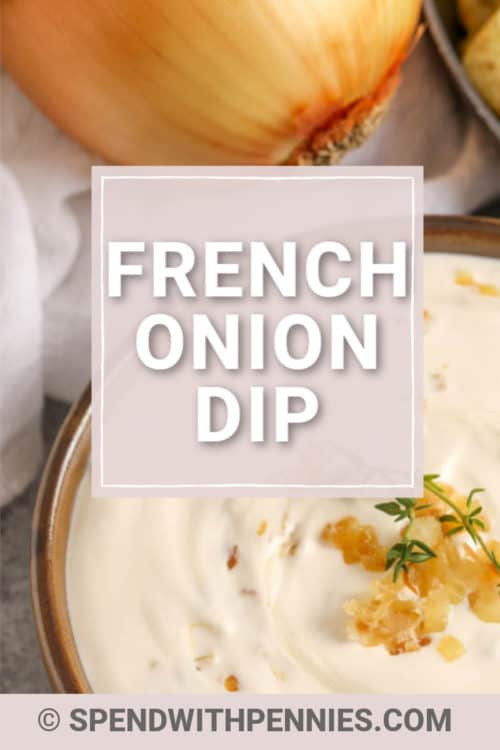 A bowl of prepared French Onion Dip garnished with caramelized onions and thyme.