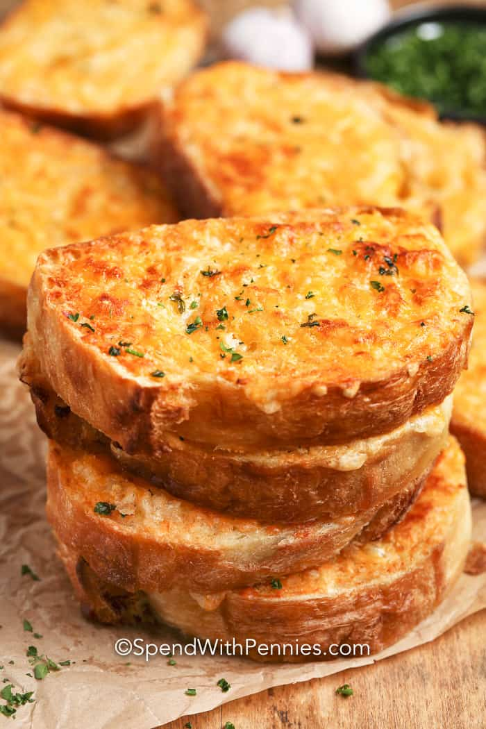 Close up of Cheese Toast garnished with parsley.