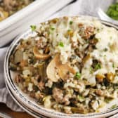 Ground Beef and Rice Casserole on a plate garnished with parsley