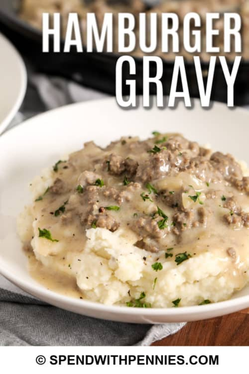 a serving of hamburger gravy on mashed potatoes.