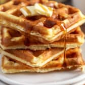 Homemade Waffles on a plate with syrup and butter
