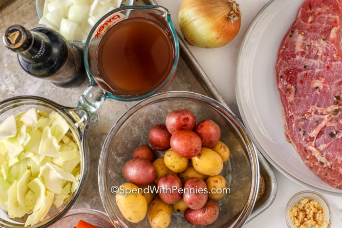 Ingredients for Instant Pot Corned Beef on a baking sheet