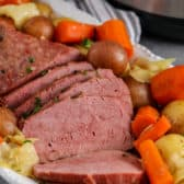 Instant Pot Corned Beef on a plate with veggies