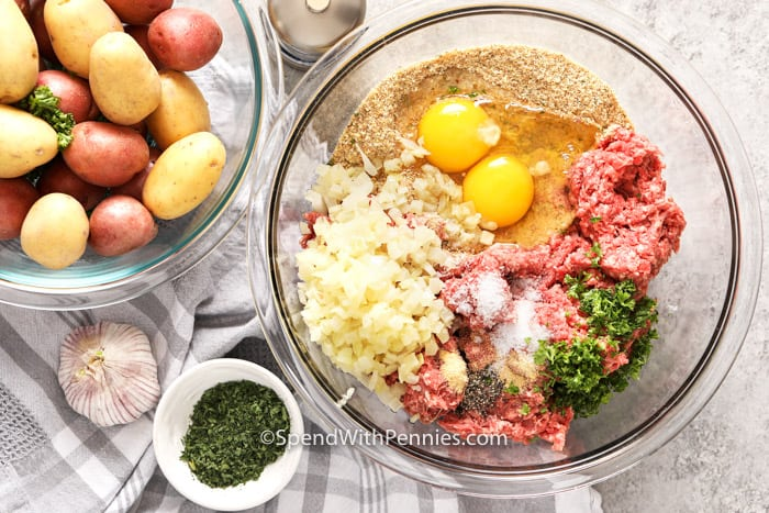 Ingredients for Meatloaf in a glass bowl.