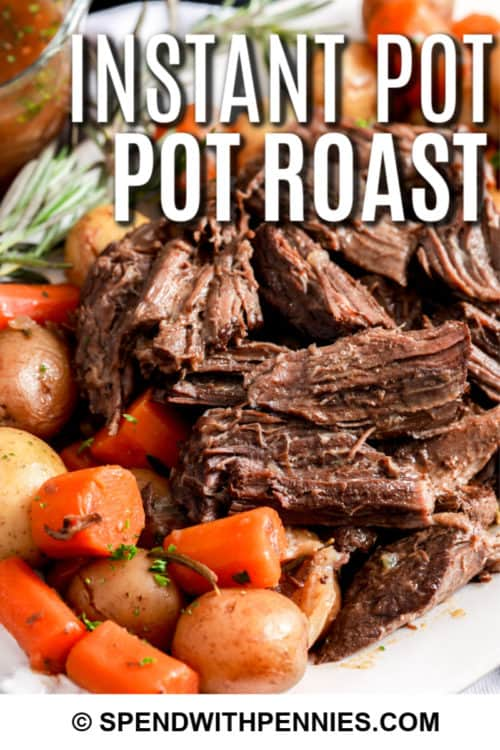 Instant Pot Pot Roast with veggies on a plate with writing