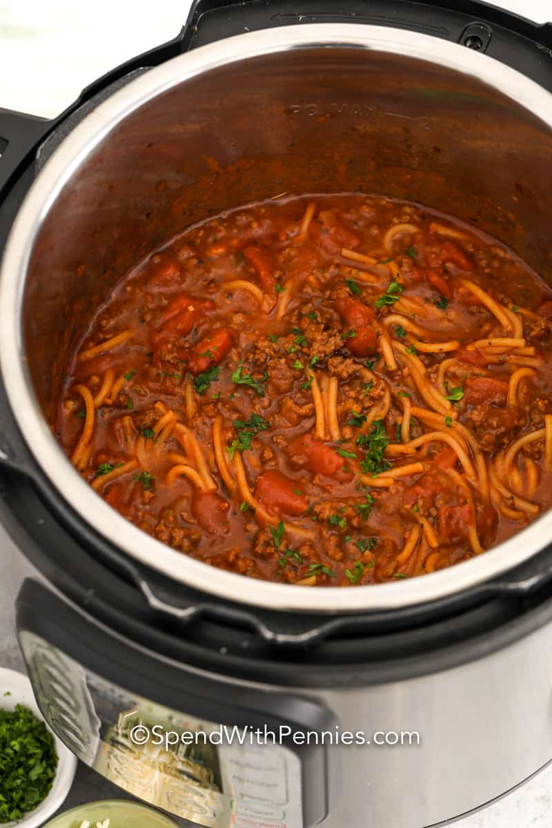 cooked spaghetti and meat sauce in a pressure cooker