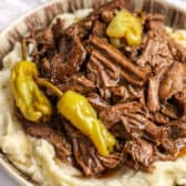 Mississippi Pot Roast in a bowl with mashed potatoes