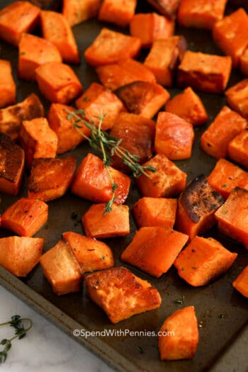 A pan of roasted sweet potatoes with thyme