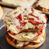 stacked pizza bagels on a plate