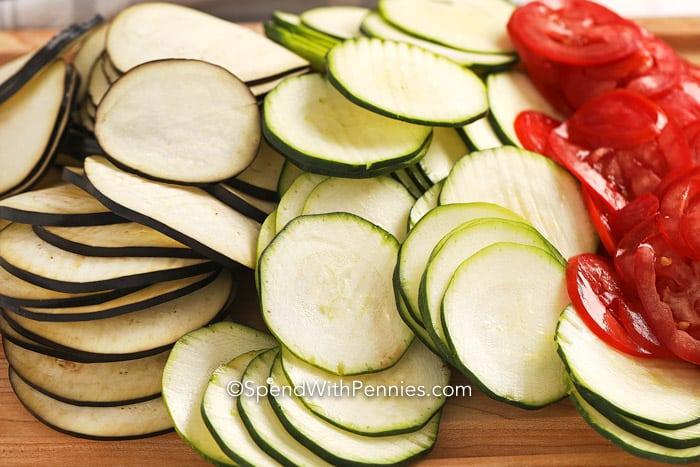 Sliced veggies for Ratatouille on a cutting board