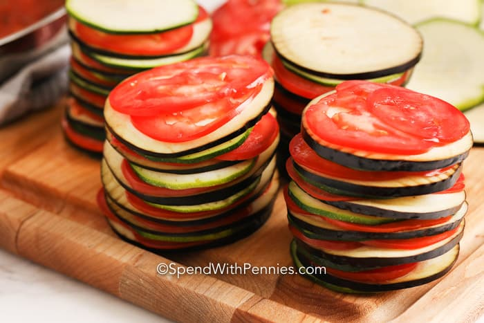 Stacks of veggies for Ratatouille on a cutting board