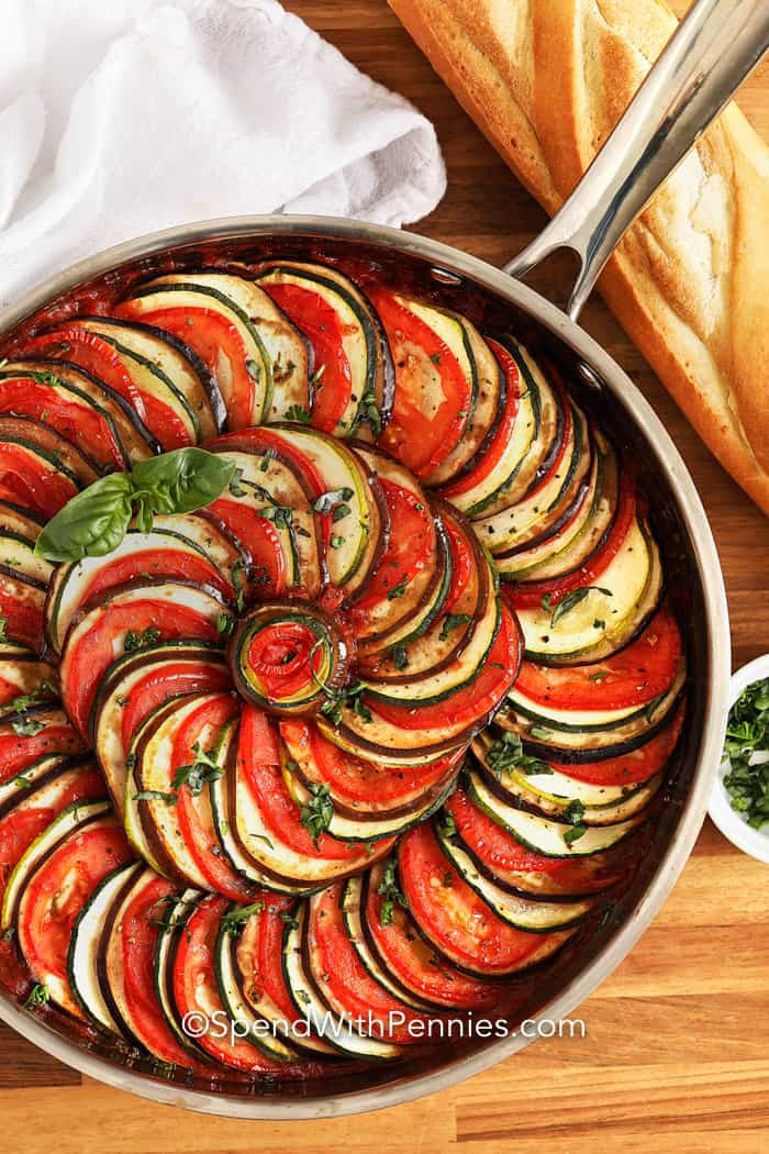 Ratatouille in a pan with bread on the side