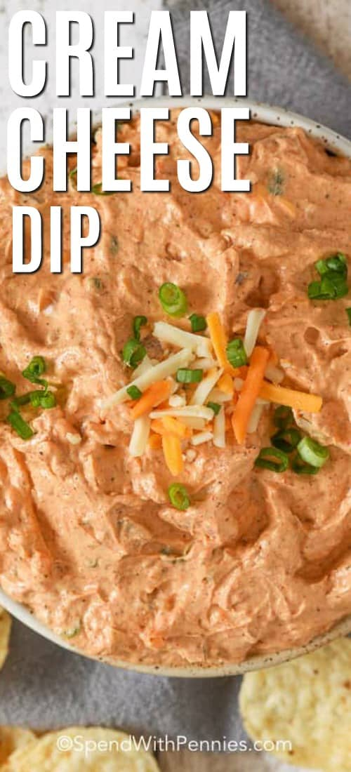 A serving bowl of Cream Cheese Dip next to tortilla chips garnished with green onions.
