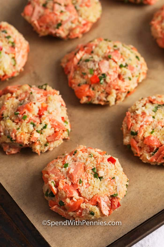 Raw Salmon Croquettes on a baking sheet