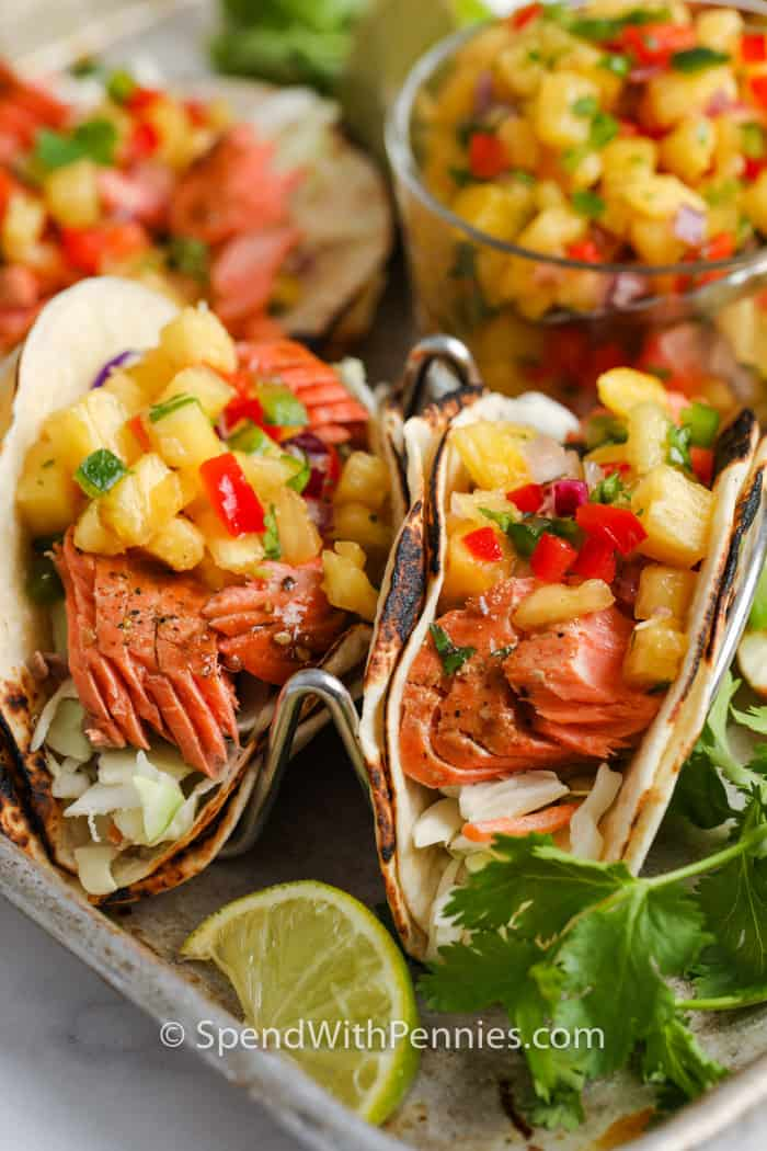 2 Salmon Tacos with Pineapple Salsa in the background
