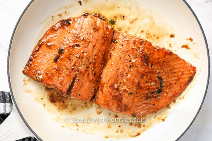 seasoned salmon in a pan for Salmon Tacos with Pineapple Salsa