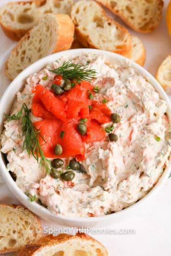 closeup of Smoked Salmon Dip with bread around the bowl