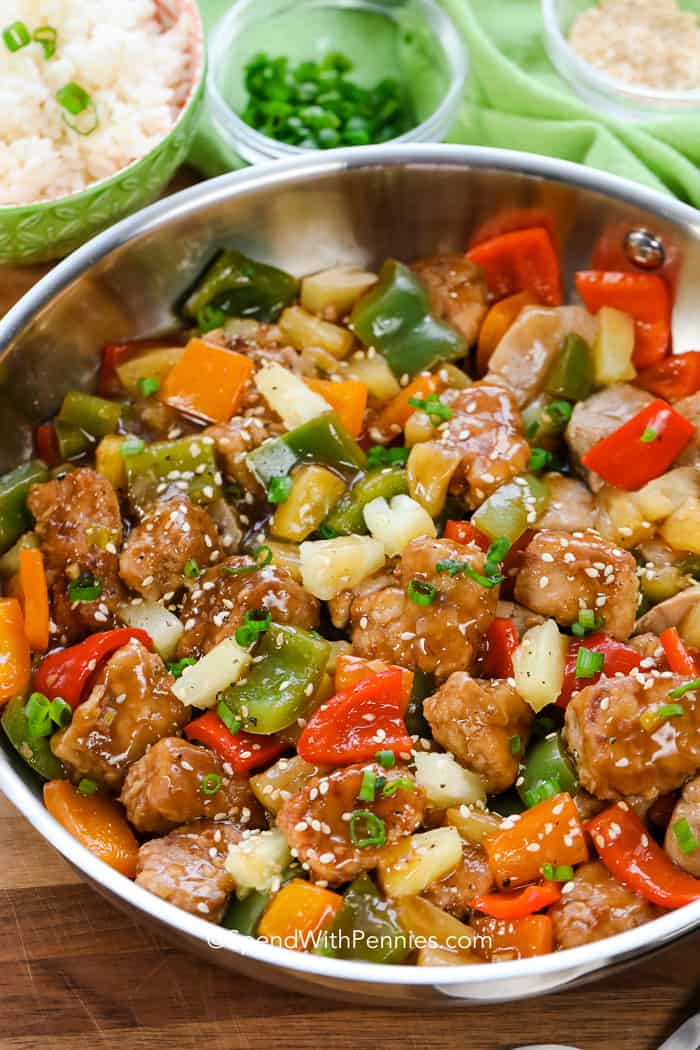 A pan of sweet and sour pork ready to serve over rice.