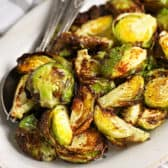 AIR FRYER BRUSSEL SPROUTS on a plate with fancy spoon