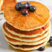 Stack of Blueberry Pancakes with syrup on it