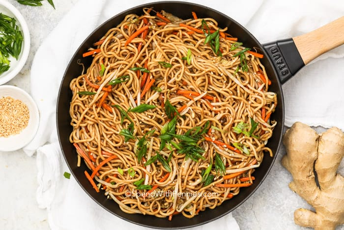Chow Mein in a pan with green onions