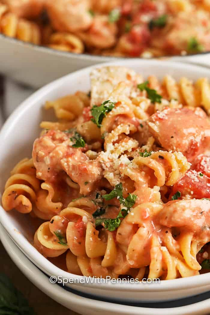 Close up of Creamy Tomato Chicken Pasta Skillet garnished with parsley.