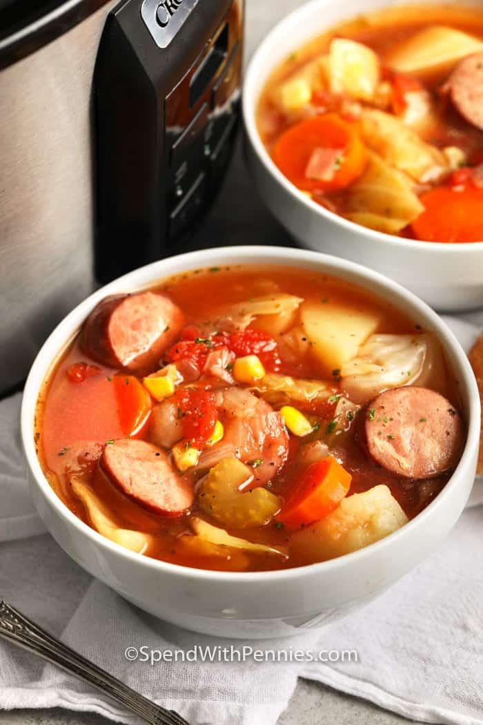 Close up of a bowl of crockpot potato and sausage soup.