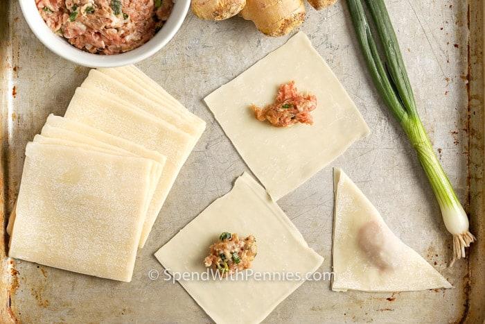 folding Fried Wontons on a baking sheet