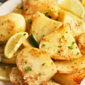 Greek Style Lemon Roasted Potatoes on a plate garnished with lemon and thyme