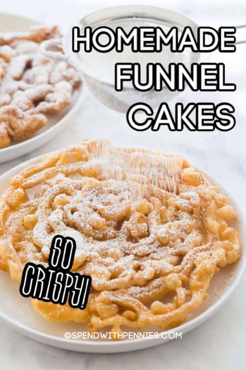 A homemade funnel cake being dusted with powdered sugar.