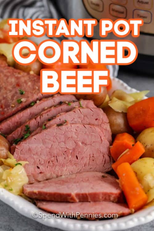 Instant Pot Corned Beef on a plate with writing