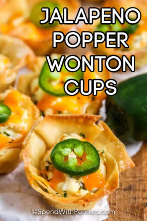 Jalapeno popper wonton cups with a slice of jalapeno on top.