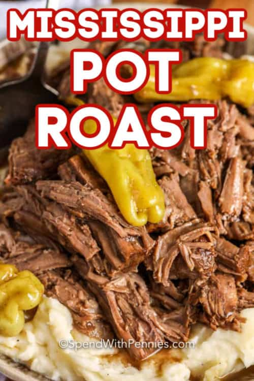 Close up of Mississippi Pot Roast served over mashed potatoes.