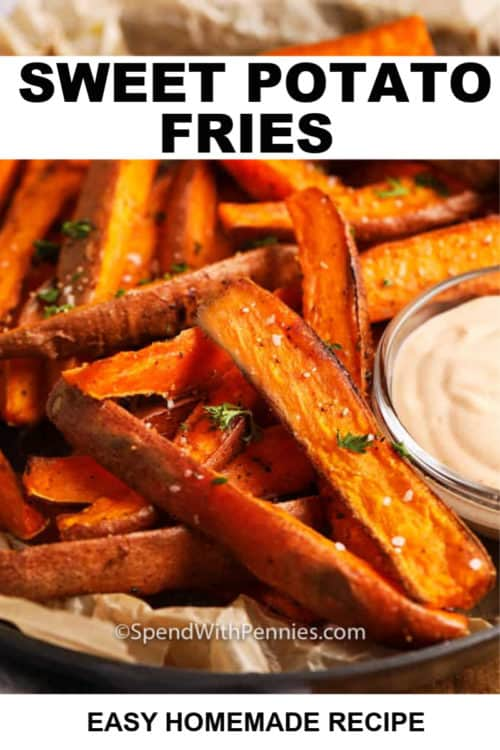 A serving dish of baked sweet potato fries with aioli dip.