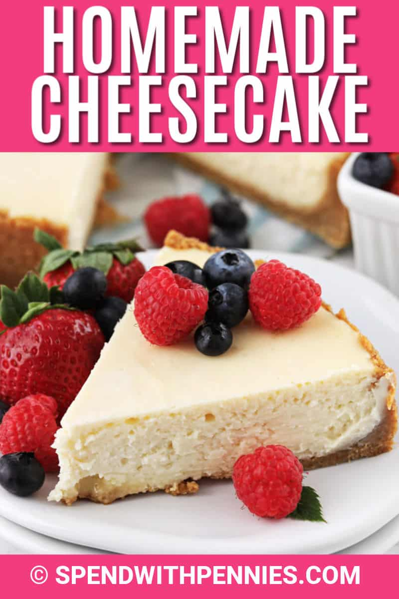 Slice of cheesecake on a plate with berries and with writing