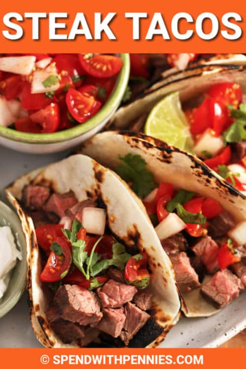 Plate with steak tacos with writing