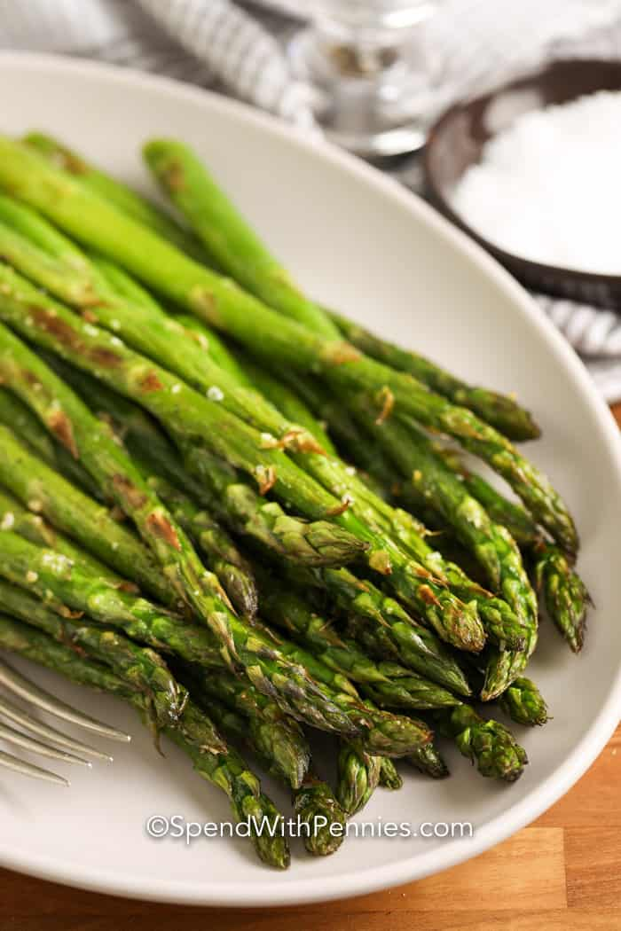 Roasted asparagus on serving plate.